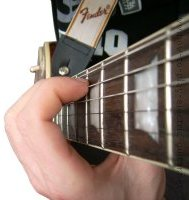 guitar fretting hand position